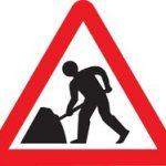 Hazard warning road work sign