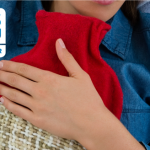 NHS image of person holding a hot water bottle